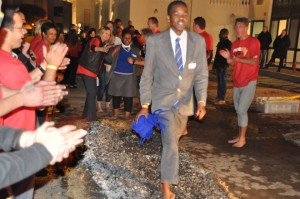 School boy firewalking